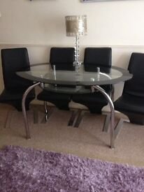 Glass table with black chairs