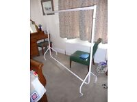 Clothes Rail. Six foot long 5 foot high. White metal as new. On casters