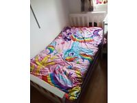 Single white wooden bed frame have a mattress spare if needed