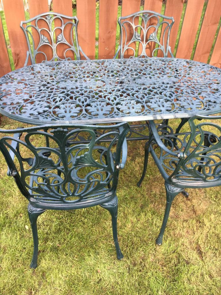 Cast aluminium green ornate garden table with 4 matching for Aluminium garden furniture