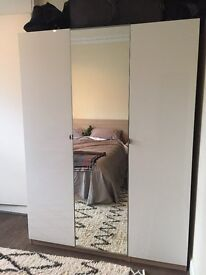 White and wood IKEA CLOSET with full-length mirror and lots of storage!