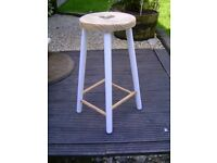 Wooden stool with heart seat