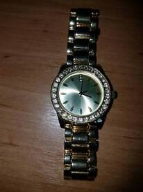 Gold coloured watch-unbranded