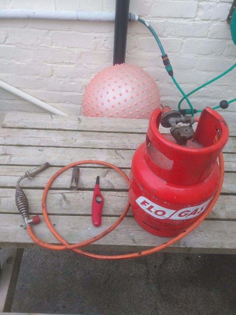 Plumbers blow torch & gas bottle.