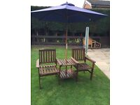 Wooden 'love seat' with parasol