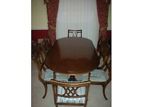 Extendable Mahogany Dining table and eight chairs [2 of which are carvers]
