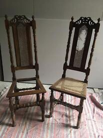 Pair of antique carved hall chairs