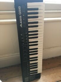 ALESIS QX49 MIDI KEYBOARD CONTROLLER AS NEW