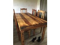 Beautiful hardwood, solid wood dining table with six chairs and matching coffee table