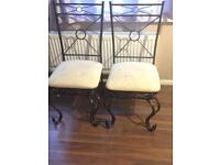 2 strong metal chairs