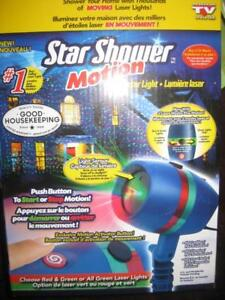 Star Shower Motion Laser Light Star Projector. Holographic Dazzling Red / Green Stars. Indoor / Outdoor Use. Water Proof