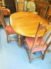 Ercol extending dining table with 6 chairs. Two carvers