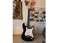Squier by Fender full size Electric Guitar, amp, & accessories