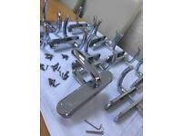 10 Sets of door handles with bars and screws like new