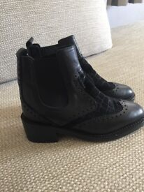 Black leather brogue style rider boots
