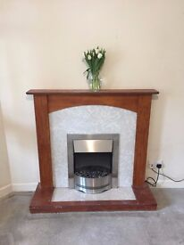 Electric fire with wooden and marble effect surround