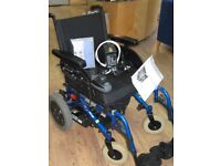 Invacare Indoor and Outdoor Powered Wheelchair with Battery Charger