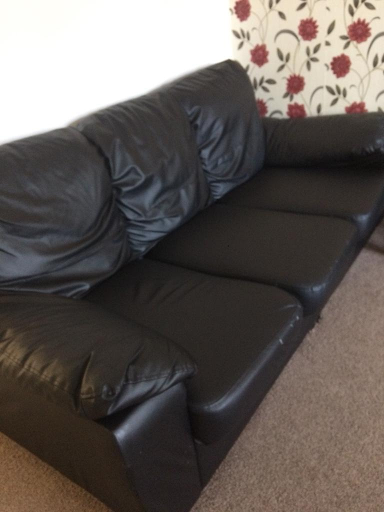 Black leather sofa 2 and 3
