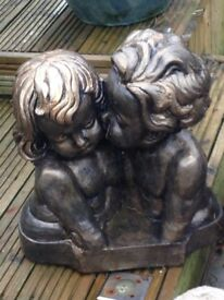 Gorgeous solid bronze effect boy and girl bust