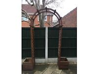 Wooden arch with planters
