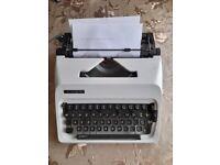 Vintage ADLER typewriter machine for display or writing. age 1980.