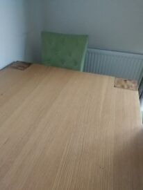 Dining table with four chairs. In good condition.