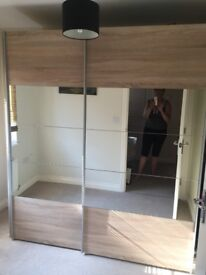 2 good quality half-mirrored oak effect wardrobes - self-assembly: to be sold as a pair/individually