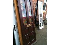 Exterior hardwood door with proper leaded glass panels