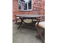 1.5m folding garden table with 4 folding chairs and cushions