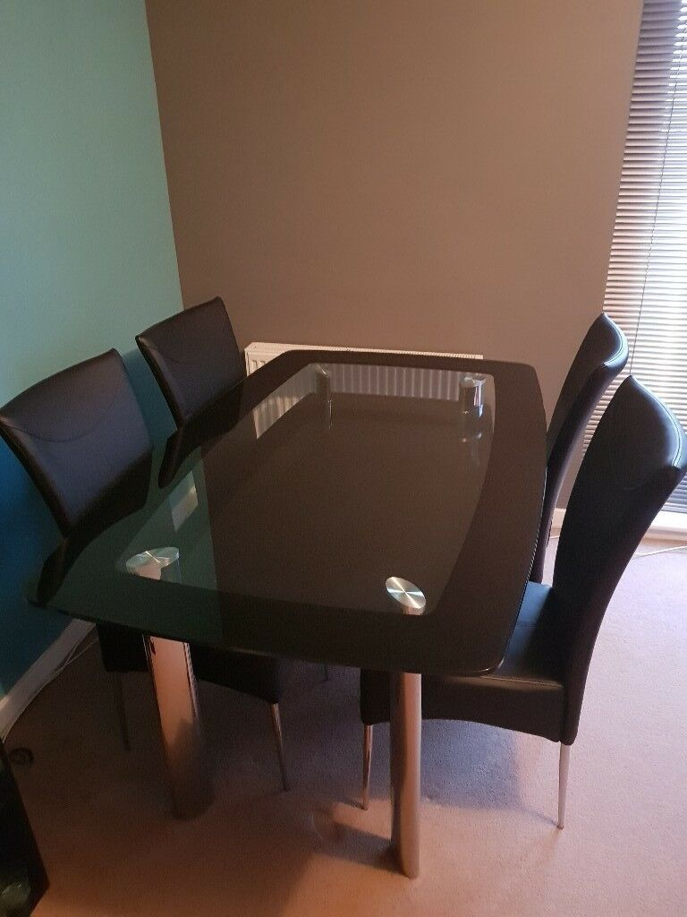 Chrome and black glass dining table with four chairs - like NEW