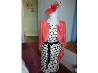 Jacques Verts dress and contrasting jacket with bag and facinator