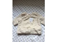 Brand new next fur jacket 0-3 months