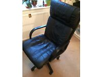 Black wheeled rotating office computer chair