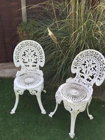 Wrought iron patio chairs ornate and rare