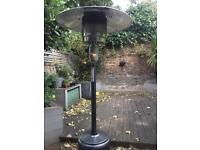 Gas patio heater with empty refillable gas tank