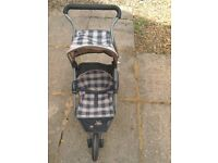 Silver Cross doll's pushchair in good condition.