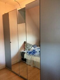 IKEA PAX Mirror wardrobe, very large, good condition.