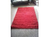 NEXT RED LARGE SHGGY RUG AS NEW