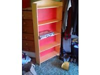 Childs wooden bookcase previously painted. Can be wall mounted or freestanding. Good construction.