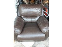 Well used but extremely comfortable brown leather arm chair.