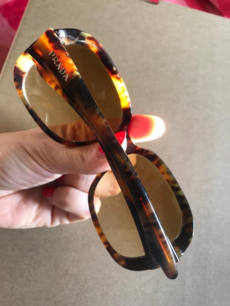 4 used sunglasses. branded Prada , Oliver Bonas, Gian Marco Venturi ...