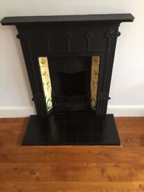 Victorian cast iron fireplace, with antique tiles