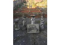Assorted stone garden ornaments.