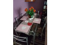glass dinning room table and 4 chairs