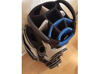 Adams trolley bag. Blue / black / white. Pre owned in good condition, no damage. 8 pockets.