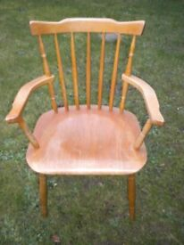 A PINE STICK BACK CARVER CHAIR