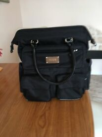 Antler Hand Luggage Black with 5 external pockets and 1 interior.