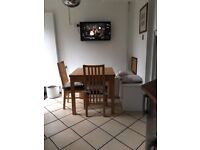 Solid wood extendable dinning table with 4 matching chairs