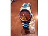 swiss ladies rolex OYSTER SEE THROUGH BACK BURGUNDY FACE