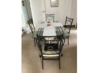 Glass to dining room table and 4 marching chairs